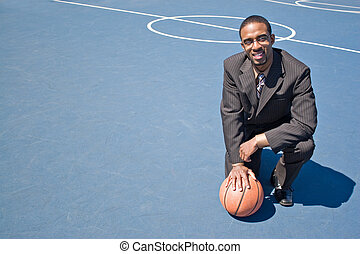 Sports Professional - A young man in a business suit posing...
