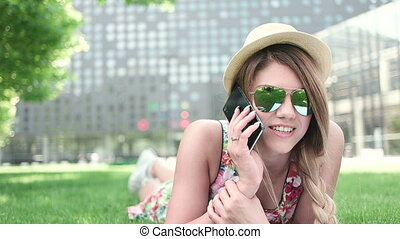 Young Woman Using Mobile Phone - Attractive young woman...