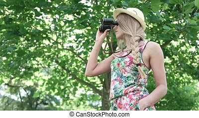 Female Tourist With Binoculars - Attractive young woman...
