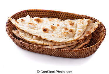 stack of indian naan bread in small basket isolated on white...