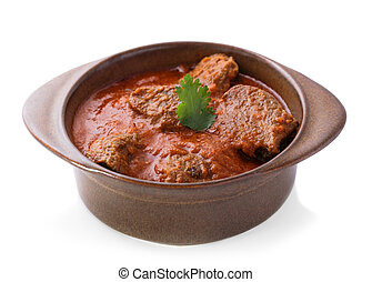 indian lamb rogan josh served in pottery isolated on white...