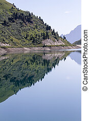 reflection on lake in the mountain
