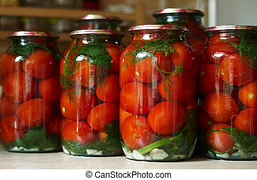 Pickled Tomatoes - Three jars of canned tomatoes lined in a...