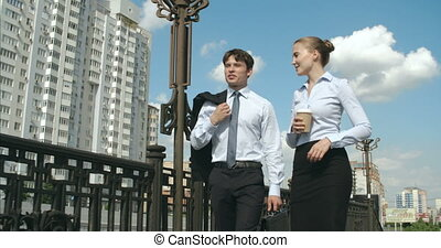 Colleagues talking - Young businessman and businesswoman...