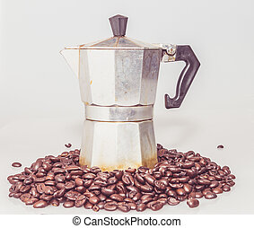 Coffee percolator on top of the coffee beans
