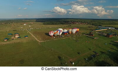 hot air baloons prerair to start, aerial view