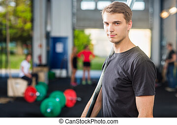 Confident Fit Man Holding Barbell Bar - Portrait of...