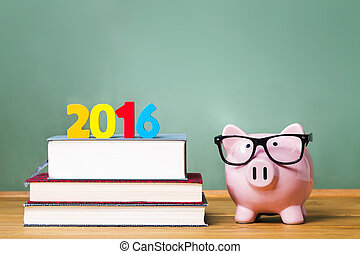 Class of 2016 theme with textbooks and piggy bank with...