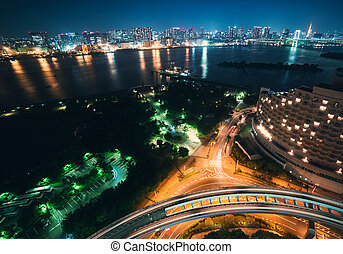 Tokyo bay and foreground traffic with downtown Tokyo in the...