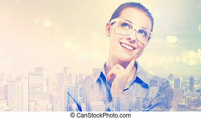 Double exposure of young professional woman in glasses on...