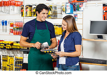 Woman Holding Screwdriver Set With Worker Swiping Credit...