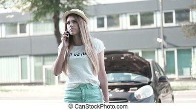 Woman Standing With Her Broken Car - Attractive young woman...