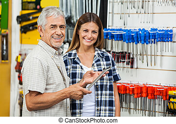 Father And Daughter With Wrench In Shop - Portrait of happy...