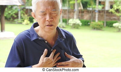 Senior Asian man heart attack - Senior Asian man having...
