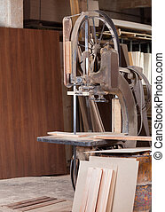 Bandsaw Cutting Wood In Workshop - Old bandsaw cutting wood...