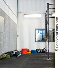 Exercise Equipment At Gym - Variety of exercise equipment at...