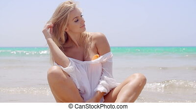 Sexy Woman at the Beach Smiling at the Camera - Pretty Blond...