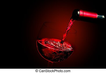 barman pouring red wine in the glass on red gradient...