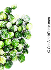 Frozen Brussels sprouts cabbage isolated on white background...