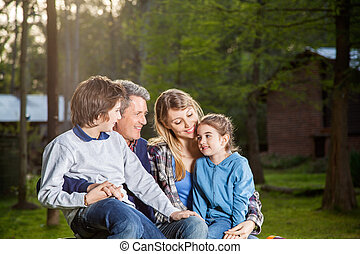 Family Spending Quality Time At Campsite - Happy family of...