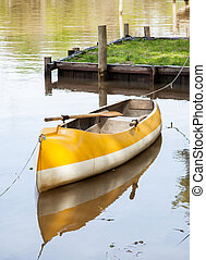Canoe Moored In Lake - Empty canoe moored in calm lake