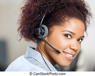 Confident Female Customer Service Agent Wearing Headset At...