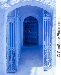 Blue gate - Blue entrance in the medina of Chefchaouen,...