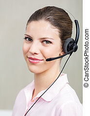Female Call Center Employee With Headphones - Portrait of...