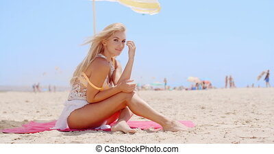 Pretty Woman Sitting at the Beach Under Umbrella -...