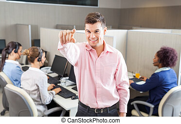 Customer Service Agent Pointing In Call Center - Young male...