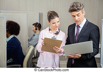 Business Colleagues Discussing In Call Center - Business...