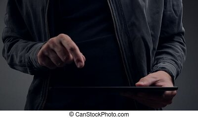Cyber criminal hands with tablet - Cyber criminal hands...