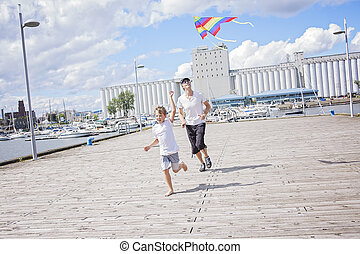 happy dad and son flying a kite together