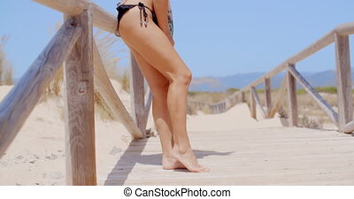 Seductive Woman Leaning Against Beach Pathway - Seductive...