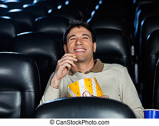 Happy Man Watching Movie In Theater