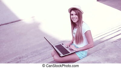 Happy Young Student Using Laptop - Attractive young woman...