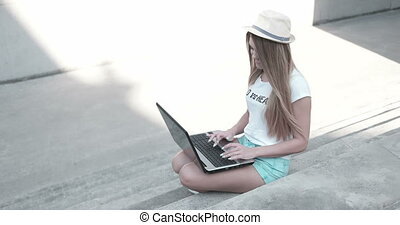 Happy Young Student Using Laptop - Attractive young student...