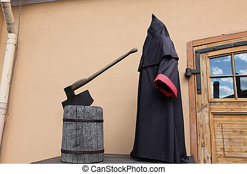 executioner at block with axe