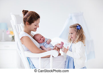 Mother with newborn baby and toddler daughter - Little...