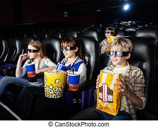 Siblings Watching 3D Movie In Theater