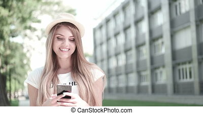 Happy Young Woman Using Phone
