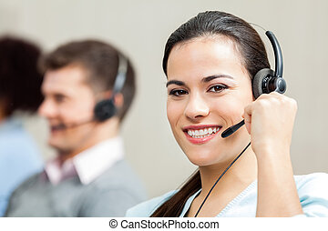 Portrait Of Confident Female Customer Service Executive -...