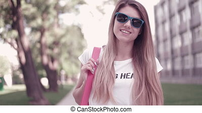 Student Walking With Bag On Campus - Attractive young...