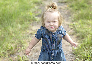 Adorable little girl in the forest meadow - An Adorable...