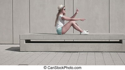 Woman Sat On Bench - Attractive young woman sat on bench.