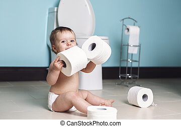 Toddler ripping up toilet paper in bathroom - A Toddler...