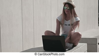 Woman On Bench Using Laptop - Woman sat on bench using...