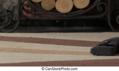 Vacuum cleaner on the carpet - home cleaning with a vacuum...
