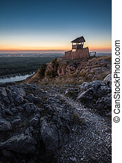 Wooden Tourist Observation Tower over a Landscape at Dusk -...
