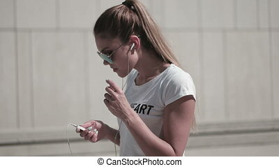 Woman Listening To Music - Young attractive hip woman...